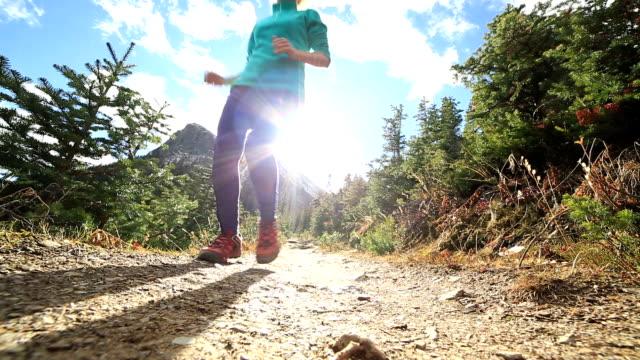 Woman running uphill video
