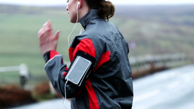 Woman Running with Smart Phone video