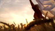 HD SUPER SLOW-MOTION: Woman Running With Veil In Field video