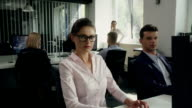 Woman satisfied at work. Corporate Business video
