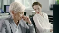 Woman satisfied with her work. Corporate business video
