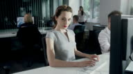 Woman satisfied with work. Businesswoman success video