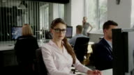 Woman satisfied with work. Corporate Business video