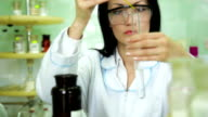 Woman scientist mixing substances a laboratory video