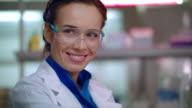 Woman scientist smiling. Female lab scientist smile. Lab woman happy face video