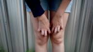 Woman scratch on body video