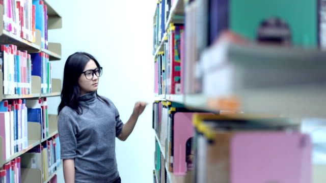 Woman search book in library video