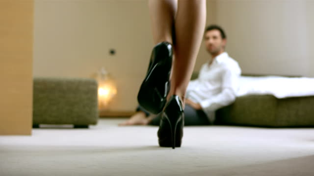 HD: Woman Seducing A Man With Handcuffs video