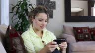 Woman sending text message video