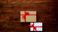Woman setting a collection of pretty gift boxes video