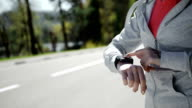 Woman setting up the fitness smart watch for running. video