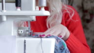 Woman sewing clothing close up shot video