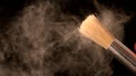 Woman shaking make up brush video