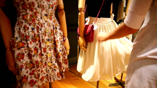 Woman shopping and checking fabric of clothes video