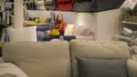 Woman shopping for furniture and home decor video