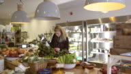 Woman Shopping For Produce In Delicatessen Shot On R3D video