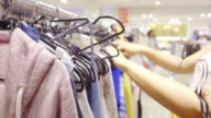 woman shopping in clothing store video