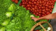 HD CRANE: Woman Shopping In Greengrocer'S Shop video