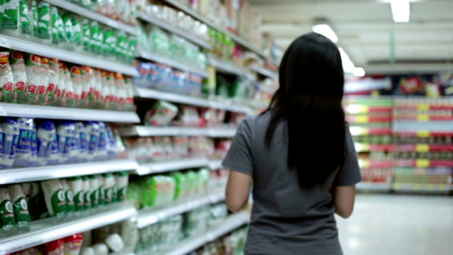 Woman shopping in supermaket video