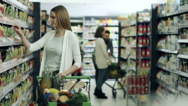 Woman shopping in supermarket video