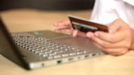 Woman shopping on internet by credit card video