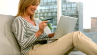 Woman shopping online with her laptop video