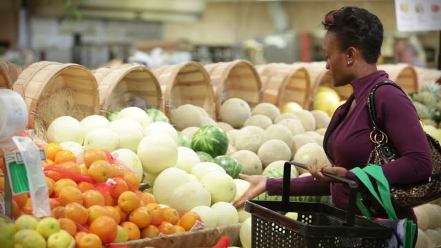 Woman shops for groceries video
