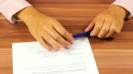 Woman signing a contract video