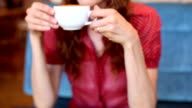 Woman sipping on a cappuccino video