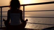 Woman sits on deck of cruise ship video