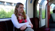 woman sitting in the tube, day dreaming video