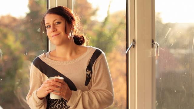 Woman sitting in window video