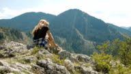 Woman sitting on a rock in the Eastern Rhodopes video