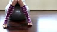 Woman sitting on gym ball video