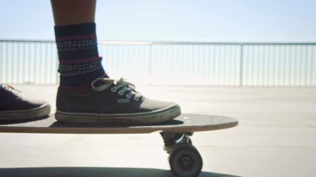 Woman skateboarding at beach video