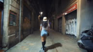 Woman skateboarding on street at night video