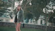 Woman skating in urban setting video