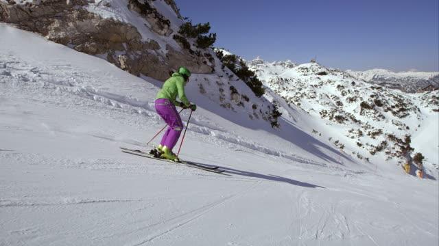 TS Woman skiing down ski slope video