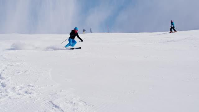SLO MO Woman skiing down ski slope video