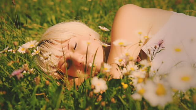 HD DOLLY: Woman Sleeping Among Spring Flowers video