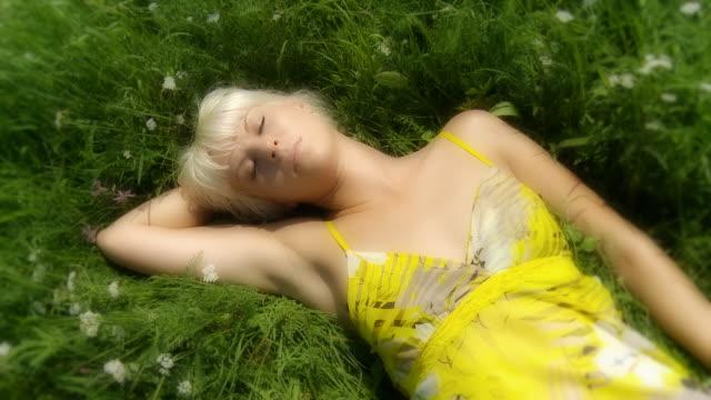 HD: Woman Sleeping In A Meadow video