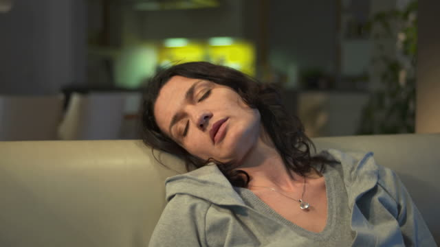 HD DOLLY: Woman Sleeping In Front Of A TV video