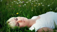 HD DOLLY: Woman Sleeping In Grass At Dusk video