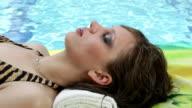 Woman sleeps near swimming pool video