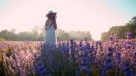 SLO MO Woman smelling lavender flowers at sunset video