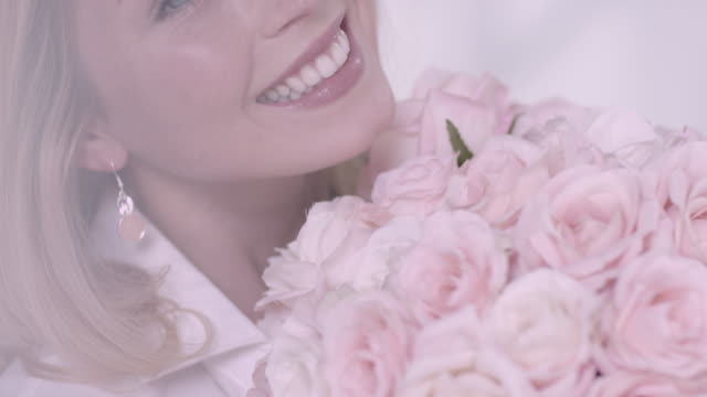 Woman smelling on flower video