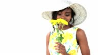 Woman smelling yellow flowers video