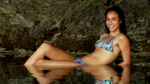 Woman smiling and relaxing in the water video