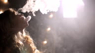 Woman smoke e cigarette, exhale thick flow, a lot of vapor fill whole frame, float smoothly video