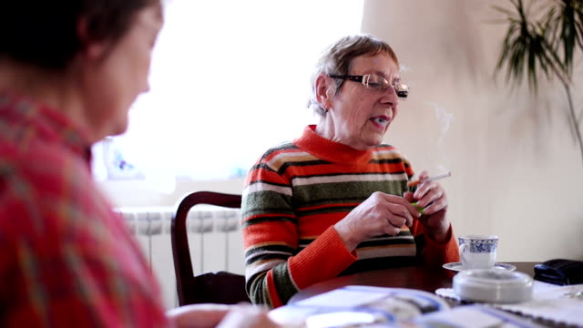 Woman smoking cigarette. video